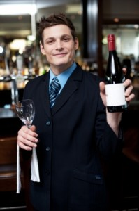 Waiter with bottle of wine
