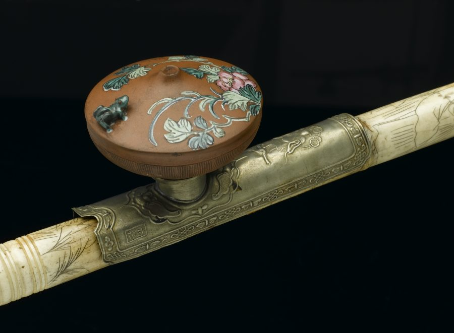 Photo of ivory opium pipe with terracotta bowl